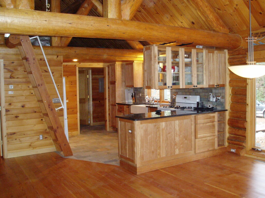 After remodel, cabinets, doug fir floor in living room and stone floor in kitchen