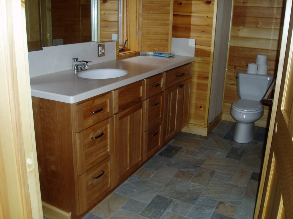 Bathroom after remodel, new vanity, countertop and stone floor
