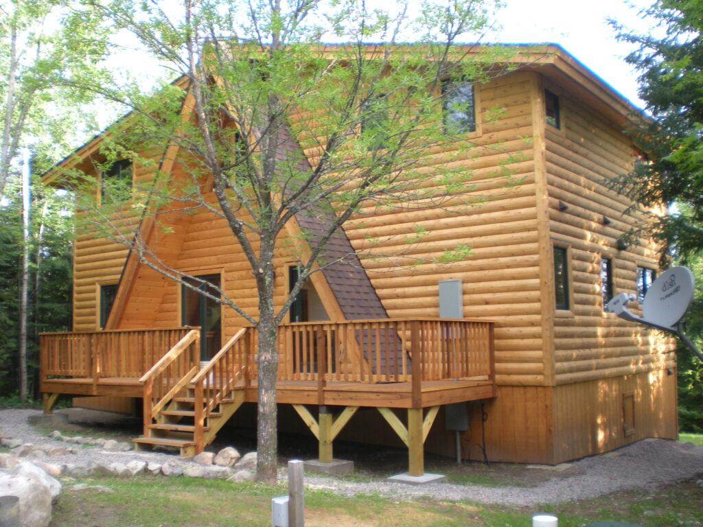 entry side, after renovation, half log siding