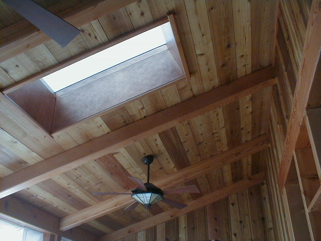 Custom milled paneling and douglas fir beams on vaulted ceiling