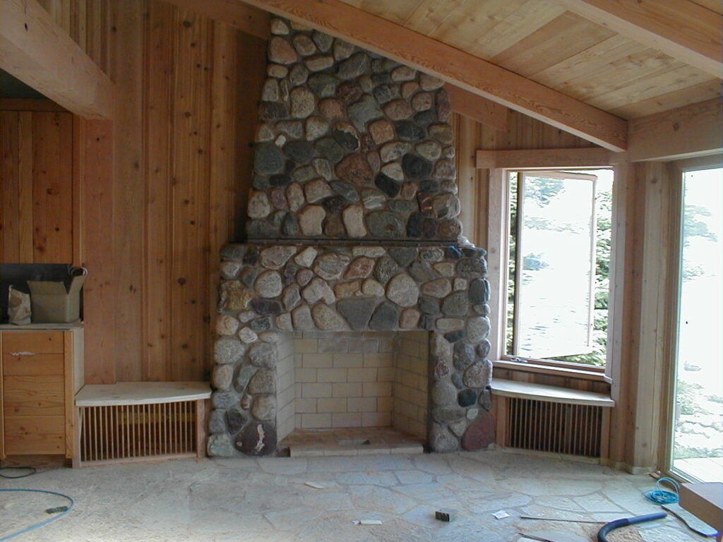New stone fireplace and stone floors