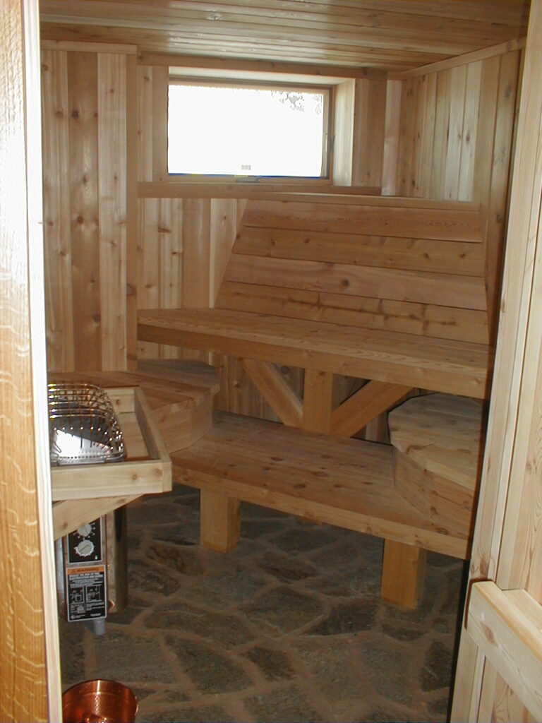 Cedar benches and paneling in sauna room