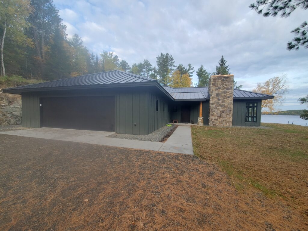 Garage entry, lake home by Huisman Concepts