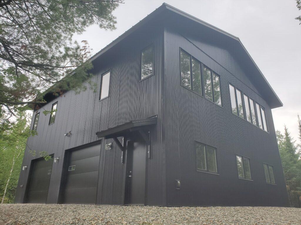 The Barn, black metal sided garage (5)