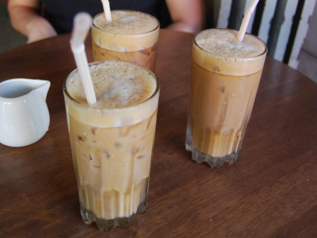 ordering drinks at a traditional Malaysiankopitiam three iced kopis