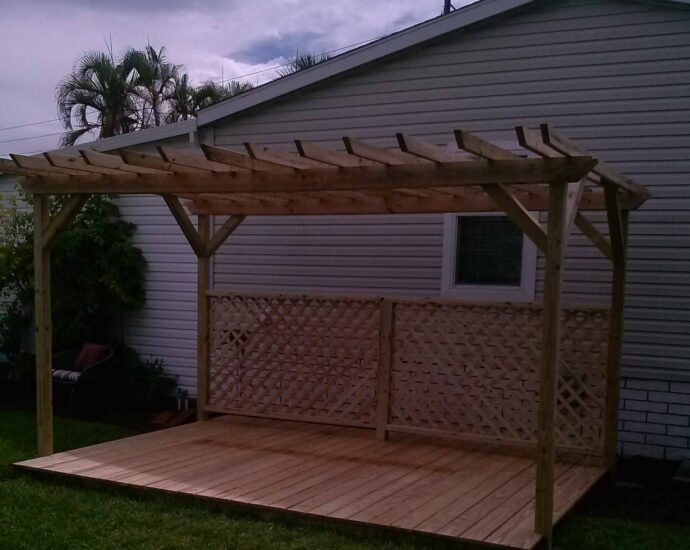 brand new deck made out of pine, with pergola
