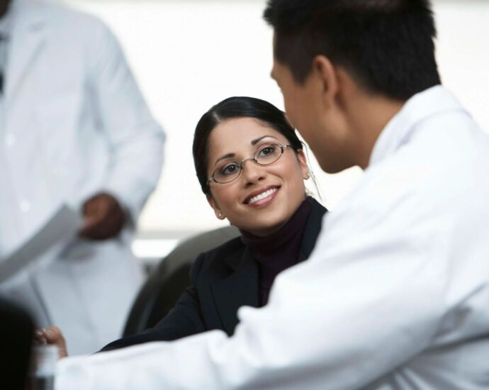 Doctor speaking with interested patient