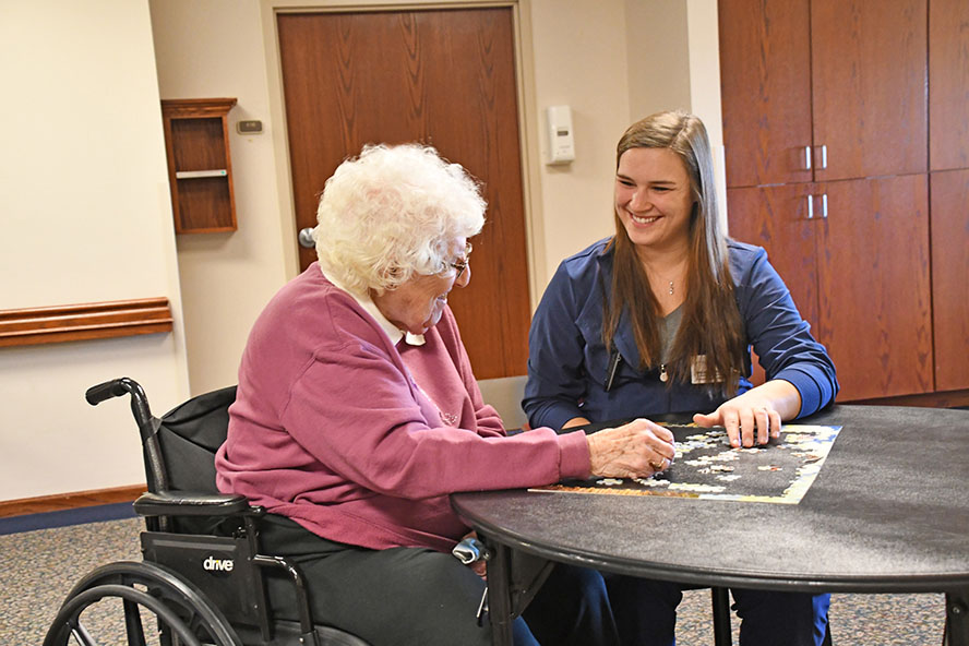 Health professional working with elderly woman