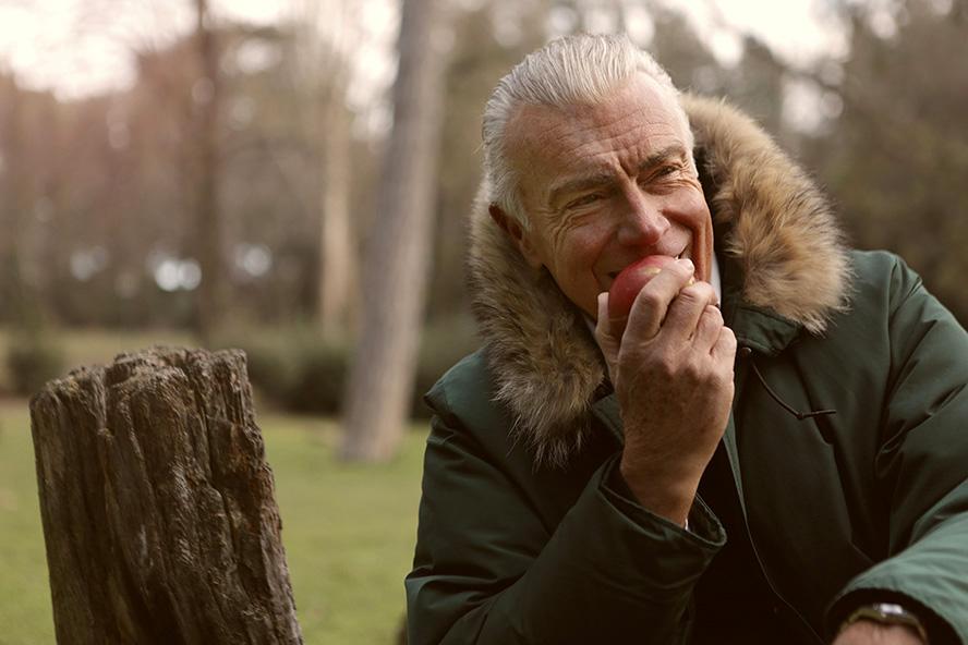 Senior man eating healthy apple