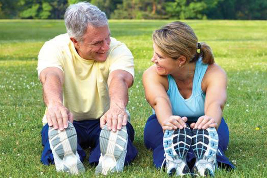 man and woman stretching before exercise in park