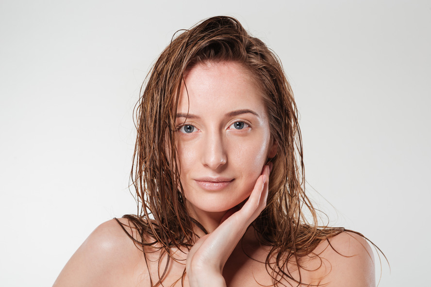 Woman touching face with healthy skin