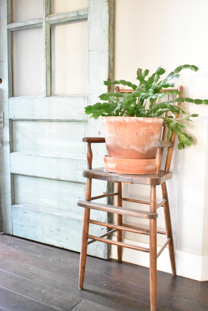vintage high chair plant stand