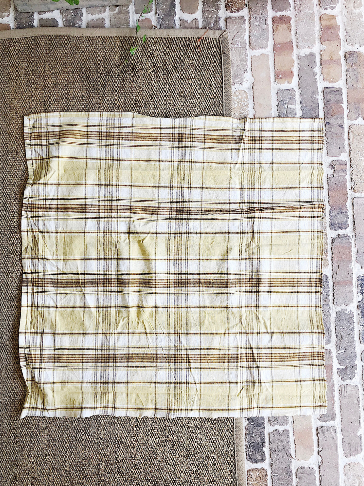 large square of gold plaid fabric to use to make a no sew fabric pumpkin