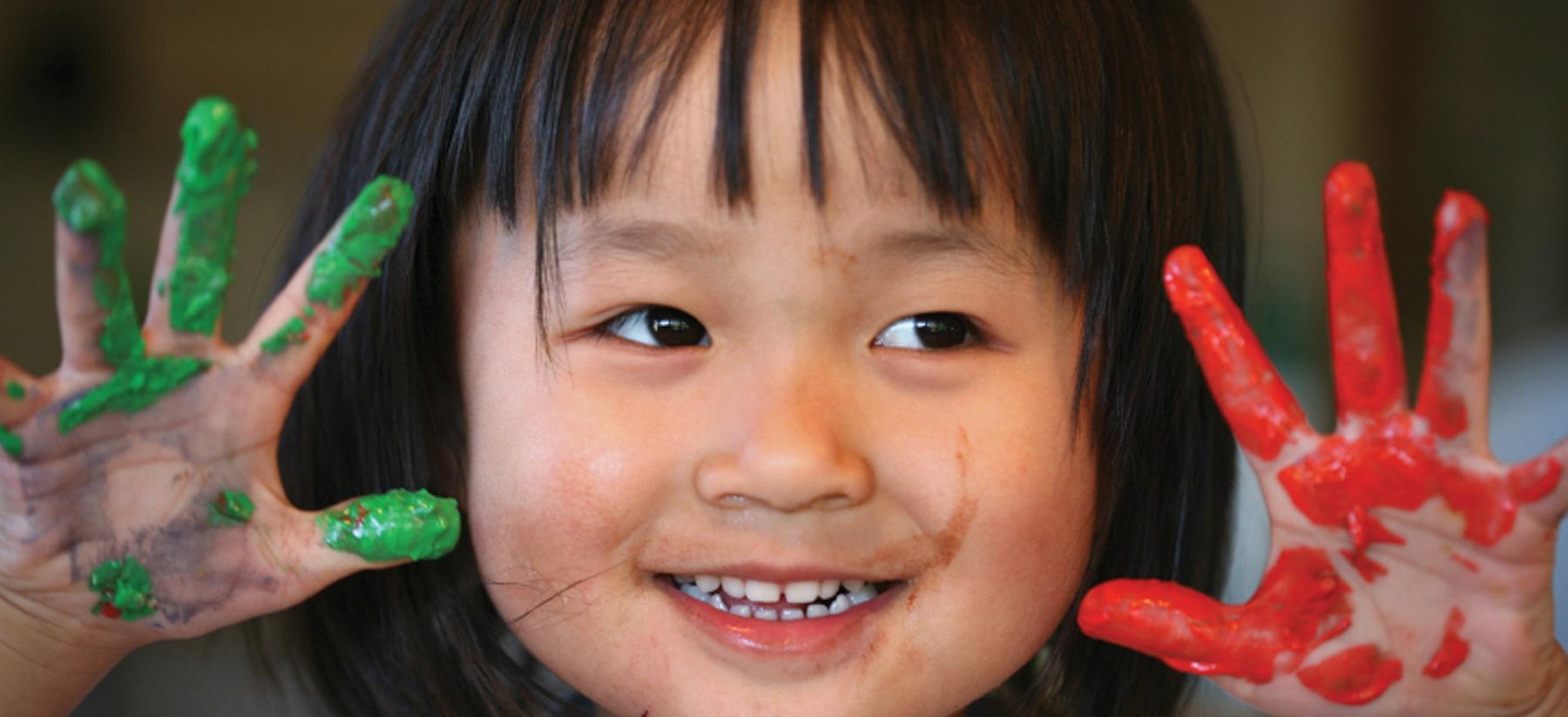 Girl Painting at Montessori Children's School of Northfield