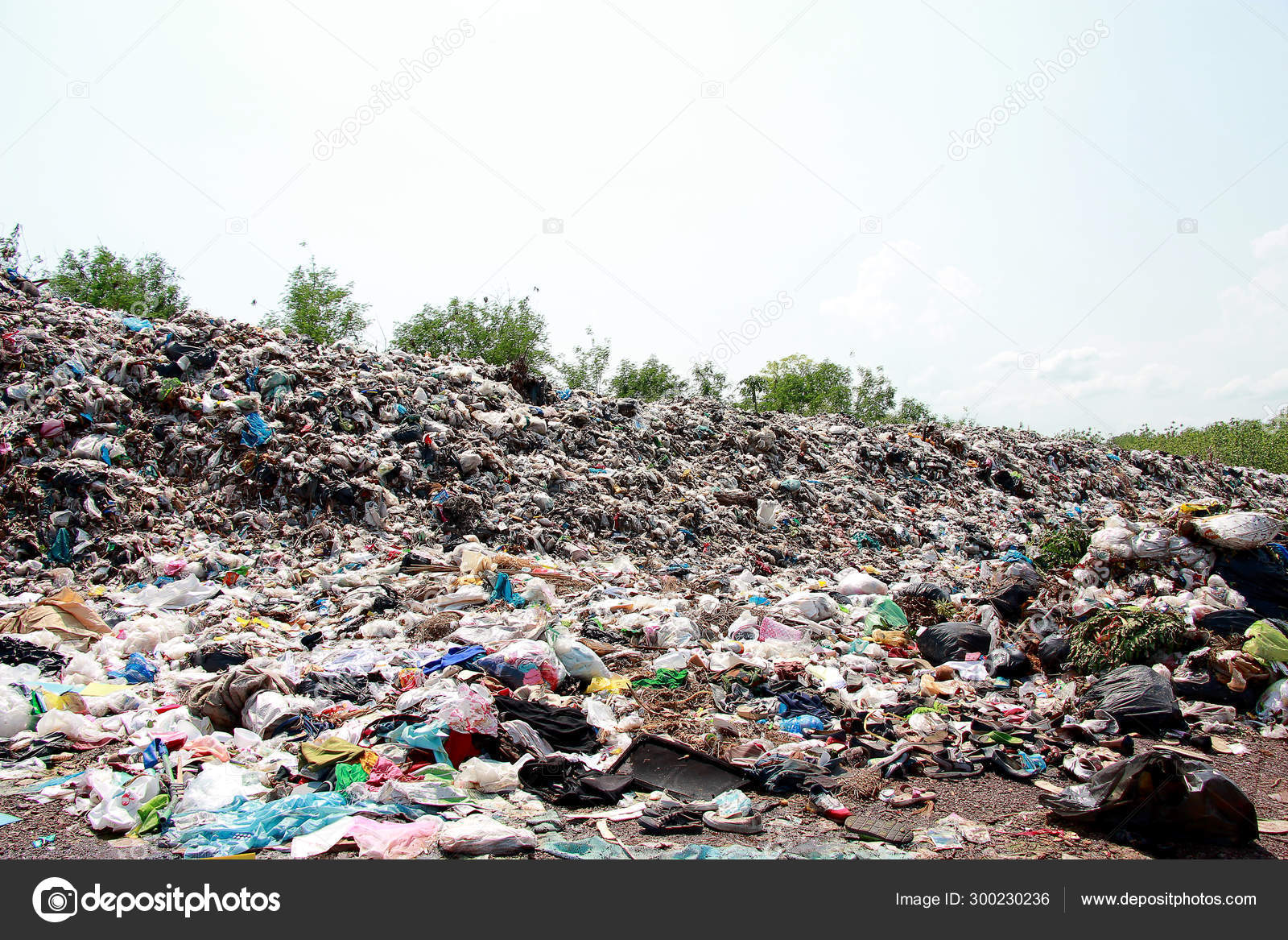 Mountain garbage, large and degraded garbage pile, Pile of stink and toxic residue, waste plastic bottles and other types of plastic waste site in trash dump or landfill. Pollution concept.