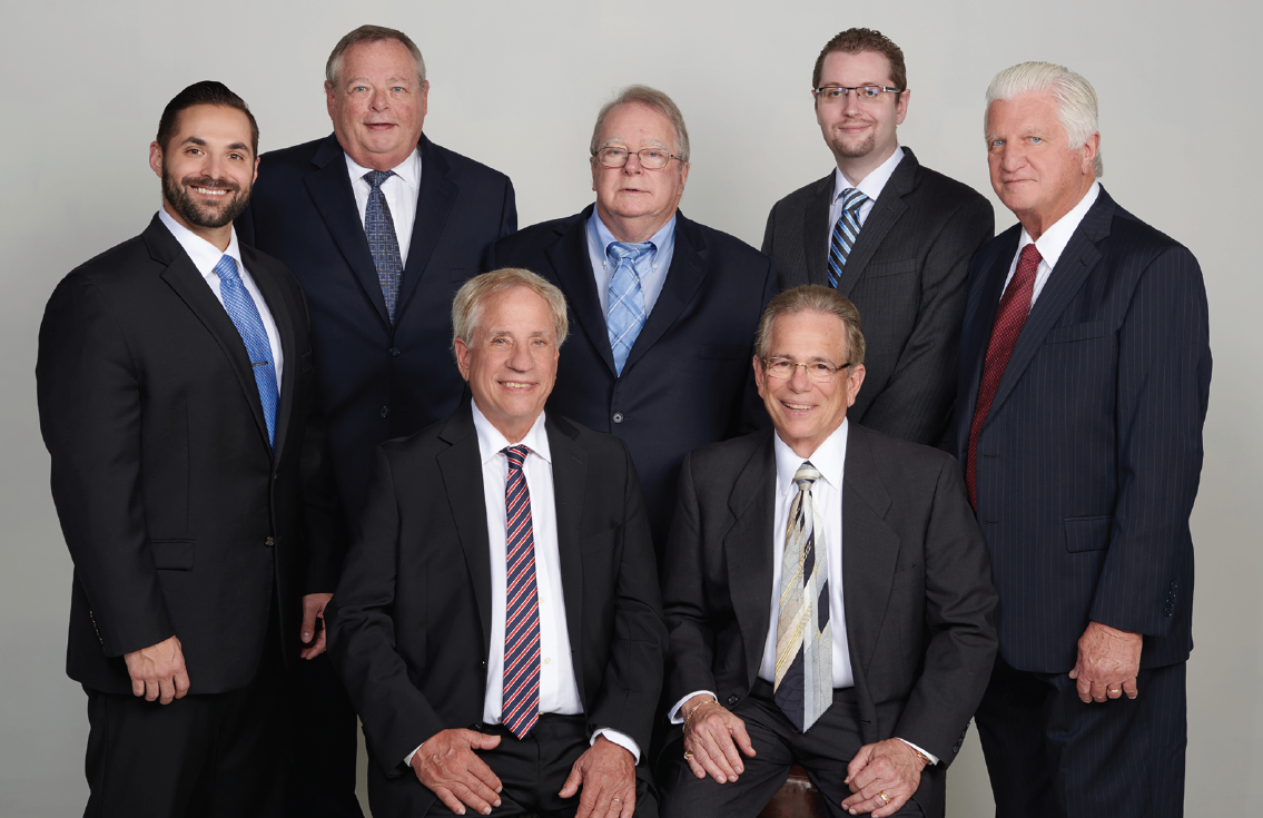 Group of seven attorneys in suits