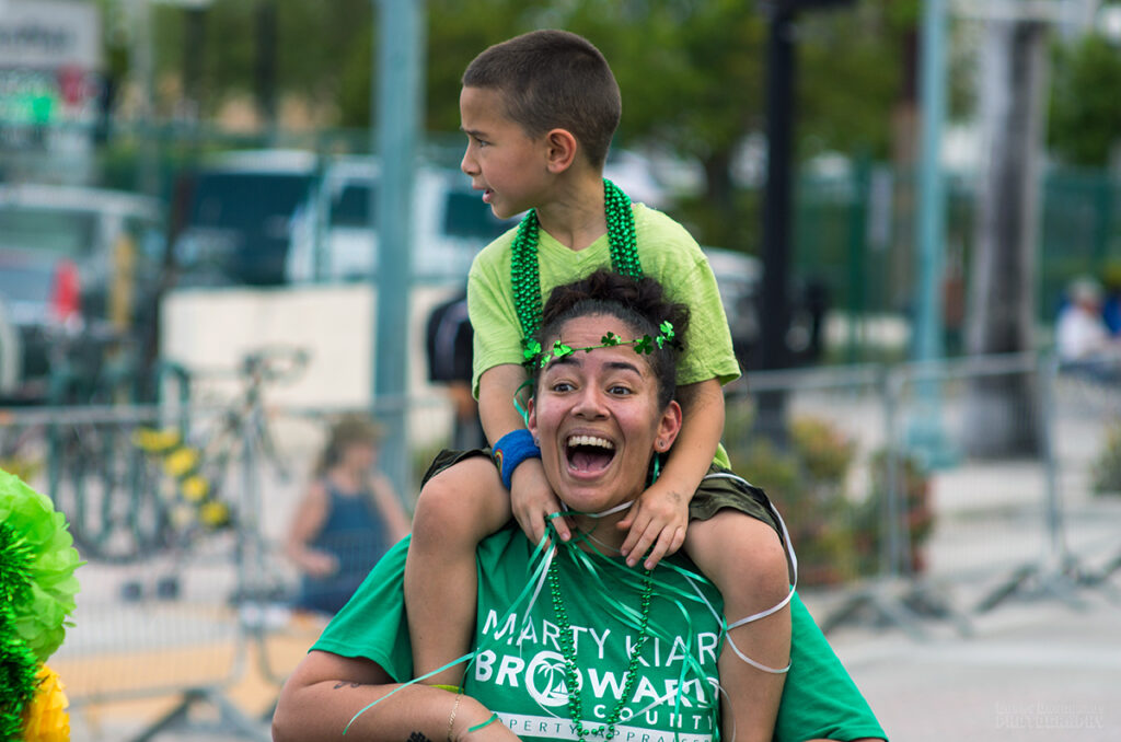 Mom with son in green