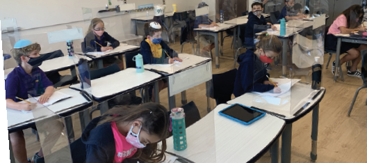 Children studying science in classroom