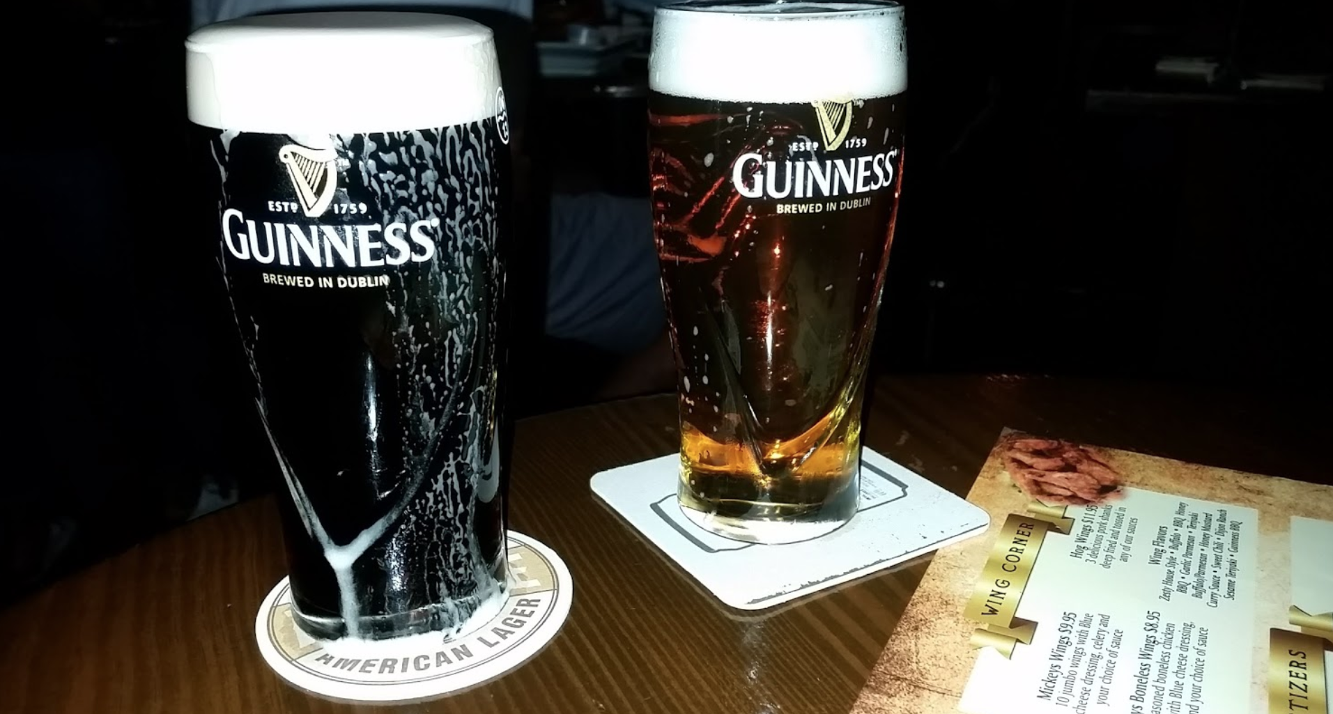 Glasses of Guiness and Harp overflowing with beer