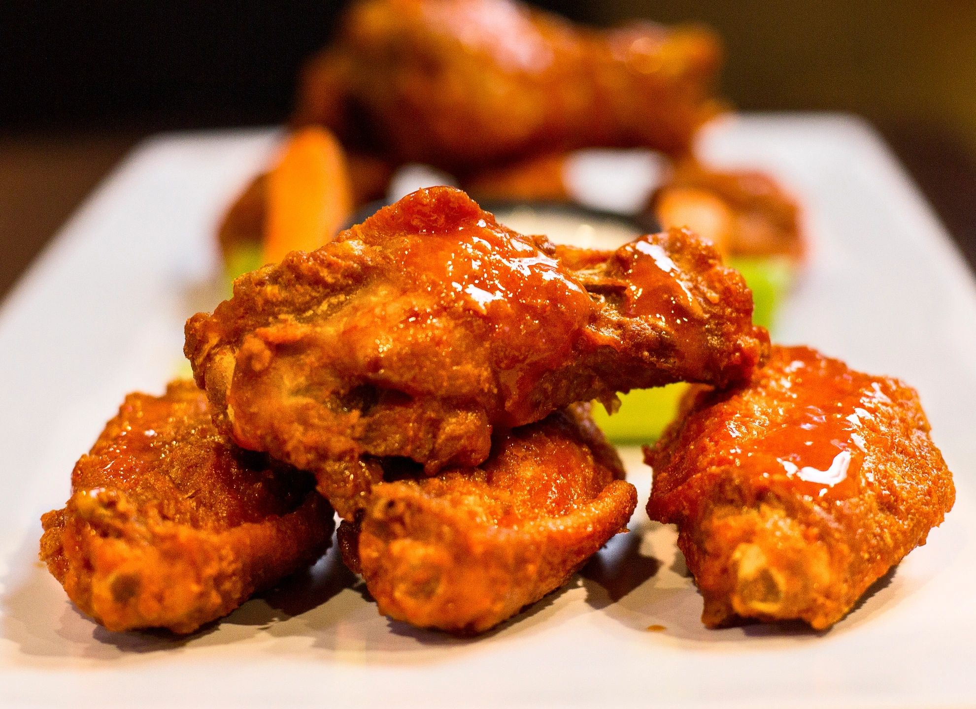 Chicken wings seasoned and covered in Buffalo Sauce