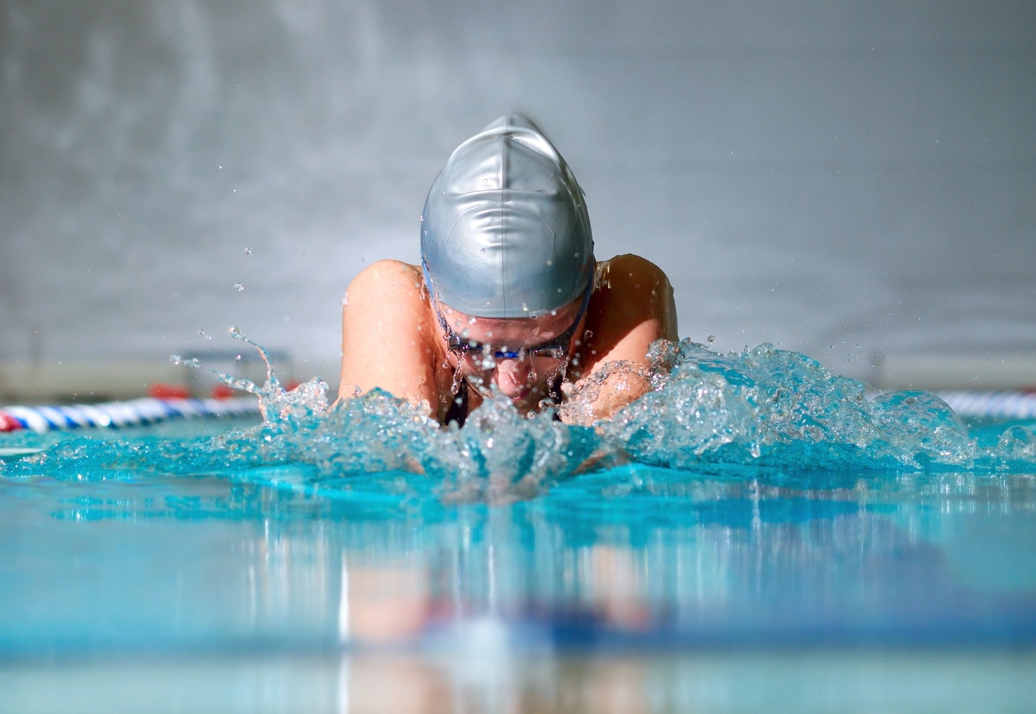 Competitive swimmer doing the breast stroke