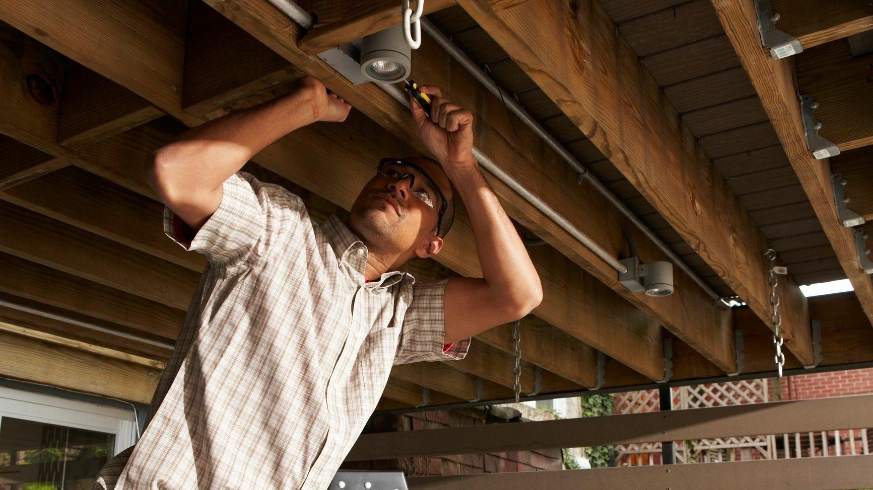 Man fixing ceiling joists