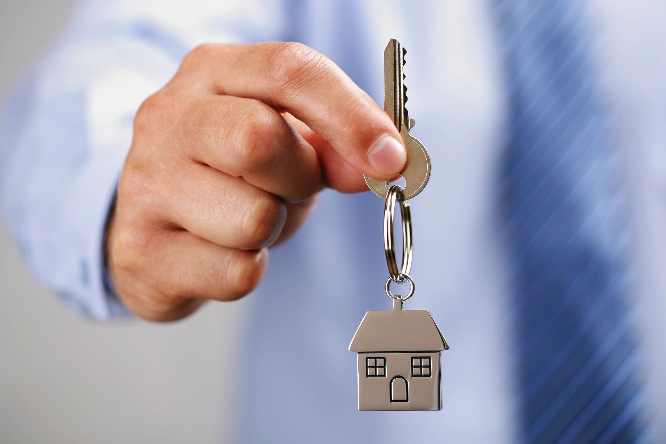 Handing over key to new house