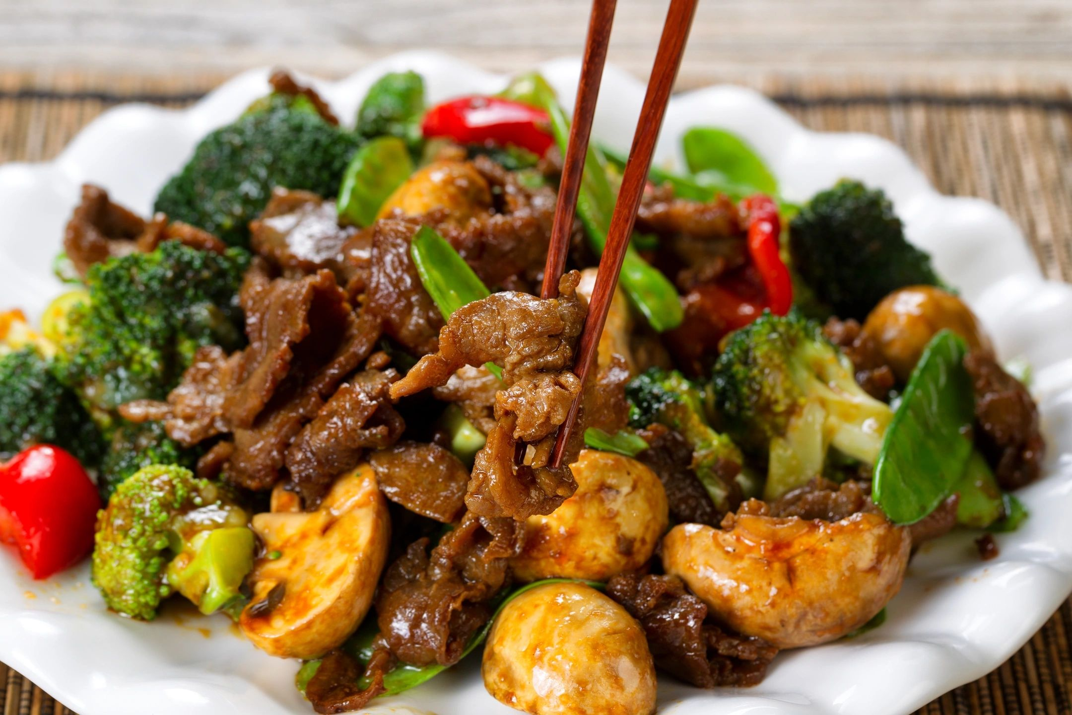 Plate of Beef with Broccoli and chop sticks