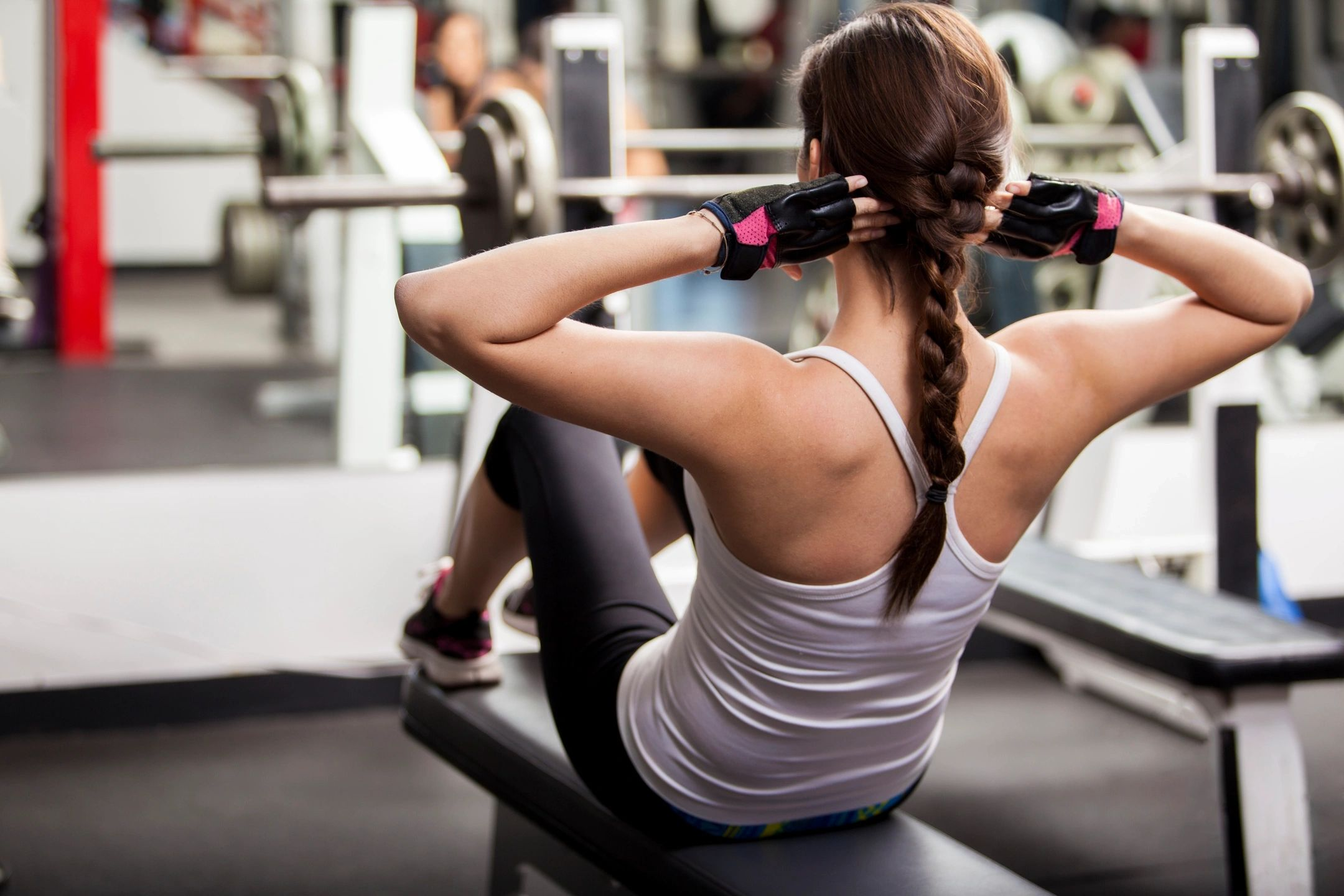 Fit woman doing situps in a gym
