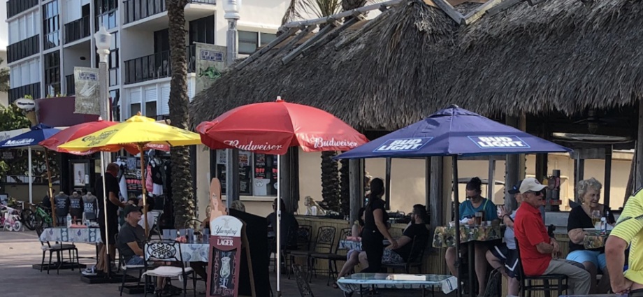 people sitting outside eating