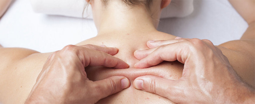 A massage therapist performs myofascial release therapy