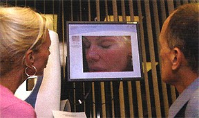 Bree Walker and Asher Milgrom PhD examine her computerized complexion analysis prior to the laser face lift procedure.