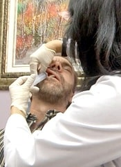 Allen receiving an ozone injection into his sinus cavity