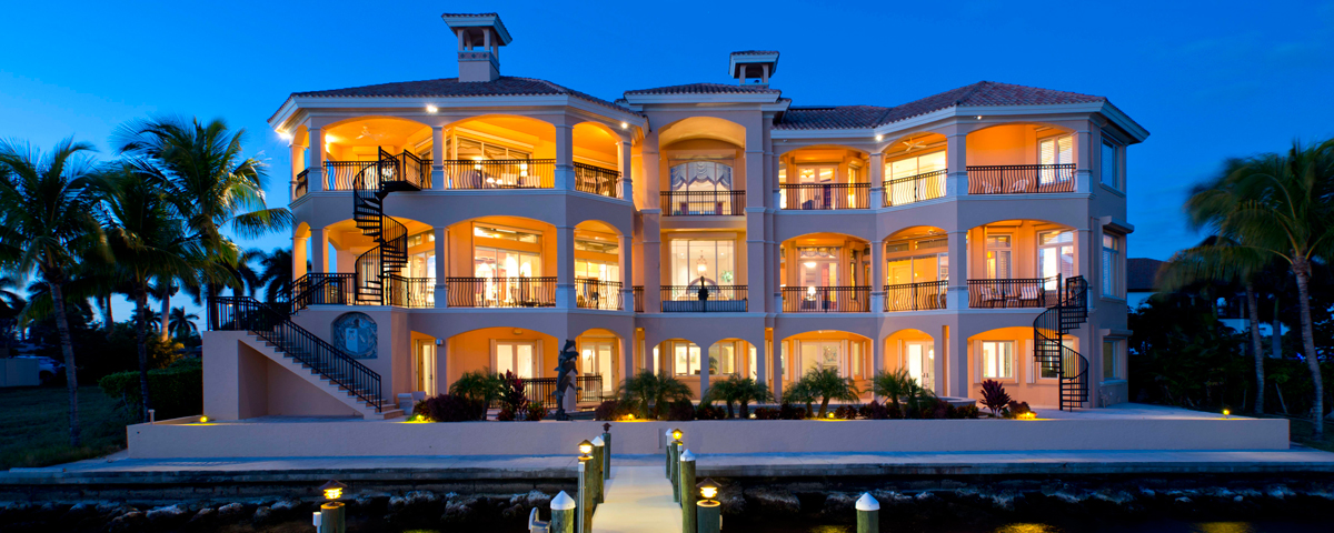 A picture of the backside of a mansion