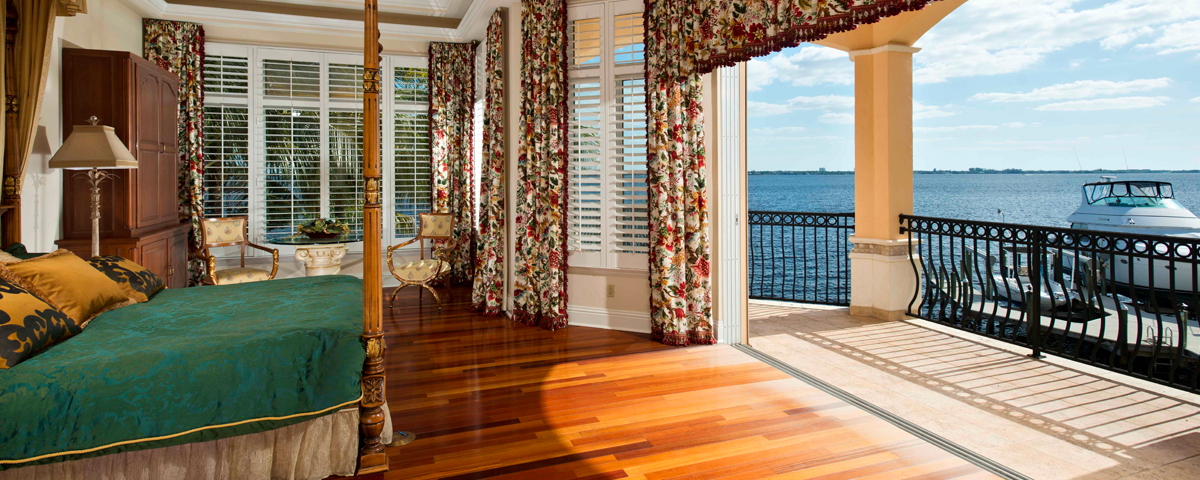 A picture of a bedroom inside a house with a view