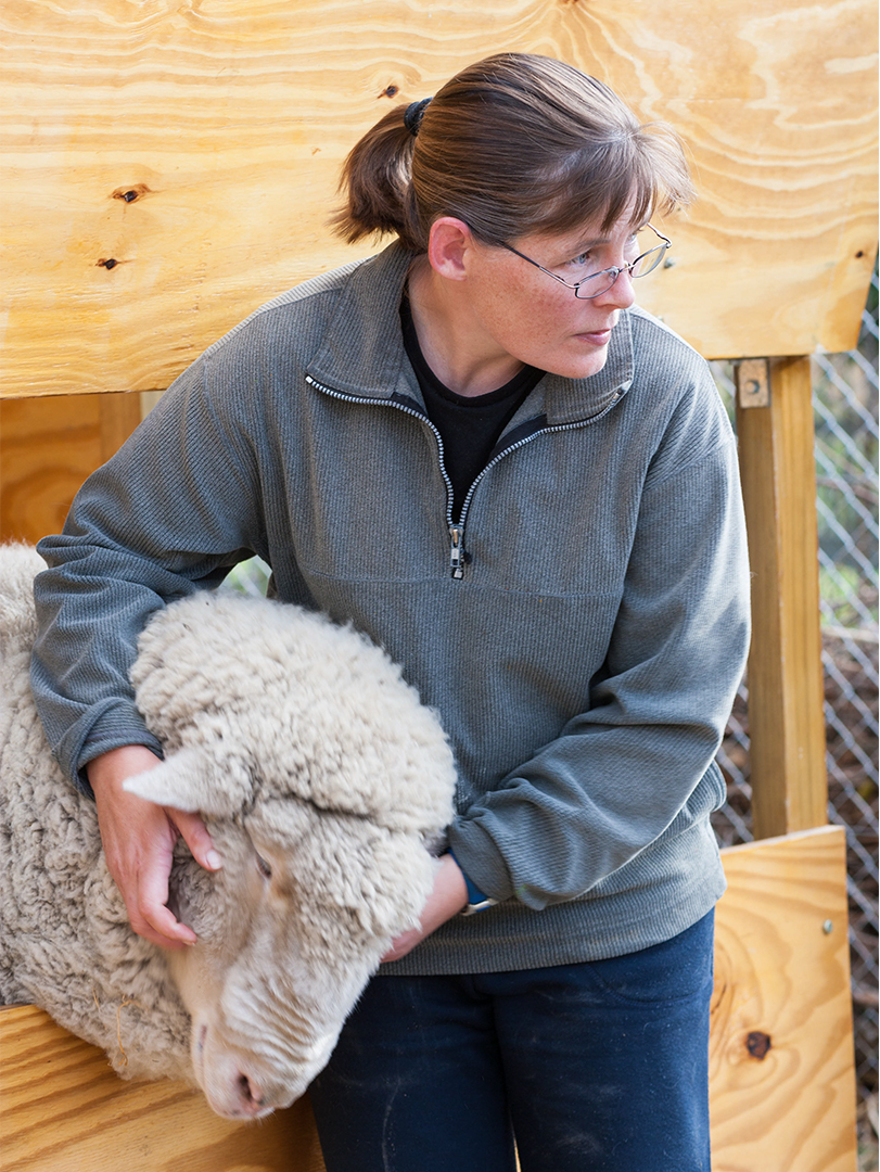 Anna Mouton with Chuck the sheep in Stanford.