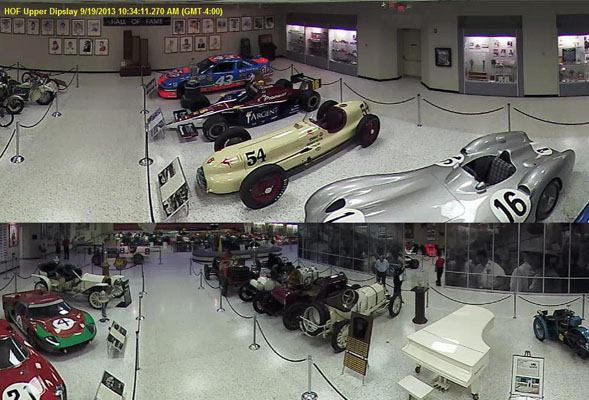 Camera over looking classic Indy race cars
