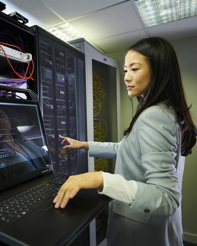 Woman working on computer server