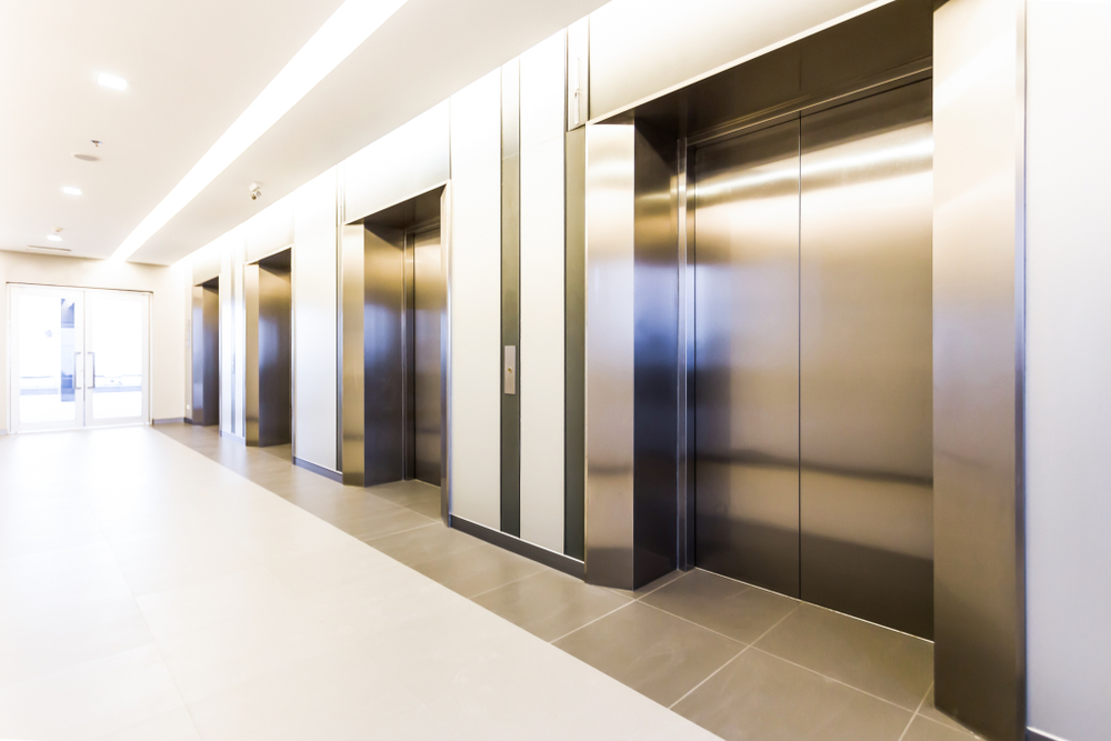 Modern,Steel,Elevator,Cabins,In,A,Business,Lobby,Or,Hotel,