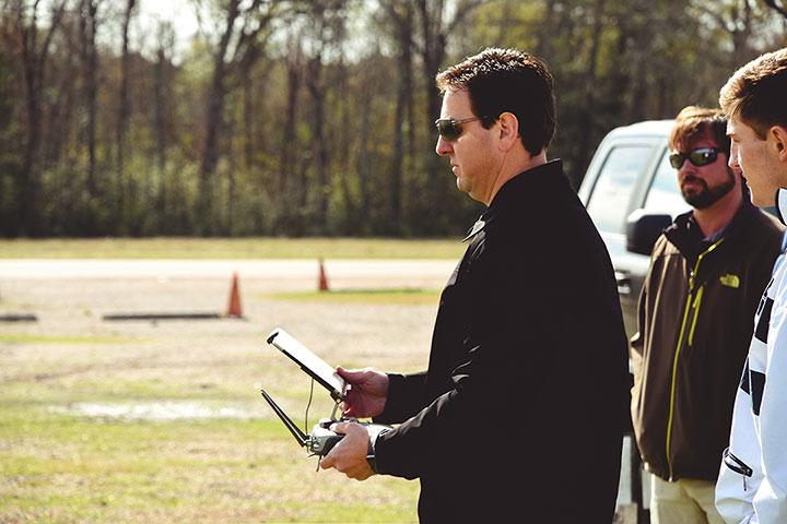 remote pilot holding DJI Inspire controller
