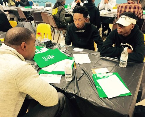 Youth talking with pro athlete at Go4It! Asset Builders Program