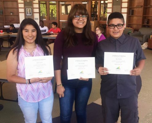 Youth with certificates from Youth Power Academy & Teen Money Camps