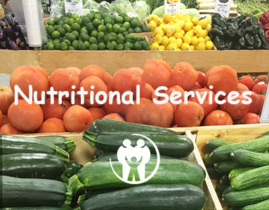 vegetable stand featuring green zucchini squash red tomatoes lemon and limes