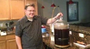 Racking an amber ale early on in my homebrew journey. Beer photo circa 2013.