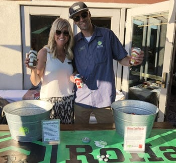 """Rob Phillips and his wife Melissa pour RoHa Brewing Project beer at Hops on the Hill. Rob is the """"Ro"""" in RoHa."""