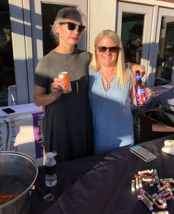 Squatters Craft Beers' Erika Palmer, left, and Amy Tangaro pour Chasing Tail Orange, among others, at Hops on the Hill.