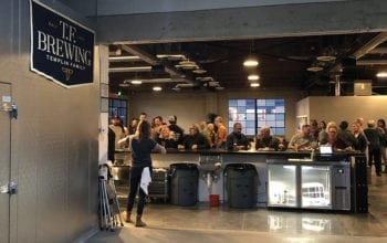 Looking out toward the taproom from the brewhouse, the two areas connect seamlessly.