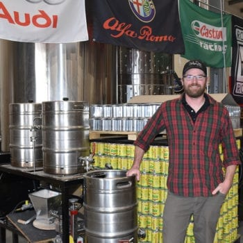 Scott Parker, Salt Flats head brewer, stands next to the 15-gallon brew system he brewed on when he came to the brewery in August 2017. Salt Flats now features a 10-barrel brewhouse.