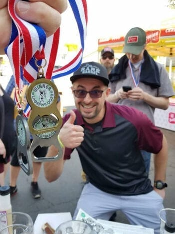 Chaz Smith picks up some hardware at the 5th Annual Lagerpalooza homebrew competition on May 5, 2019. He earned Best of Show honors at the just-completed 2020 competition.