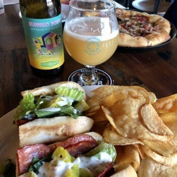Red Rock Brewery's Buffalo Point Hazy IPA and Slackwater's Joe Pesci sandwich.